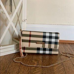 Handbags - Chained cross body wallet.